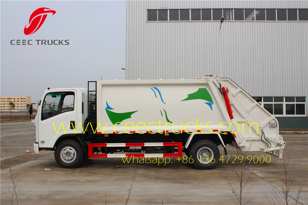 ISUZU 8cbm refuse comression truck side view